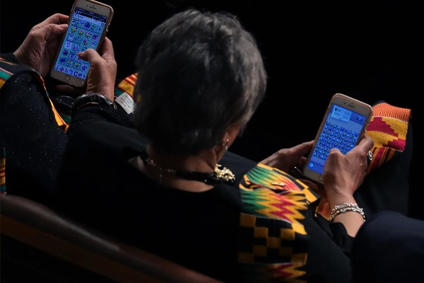 A Democratic congresswoman playing Kitty Snatch on the right, and her staff playing Big Barn World on the left