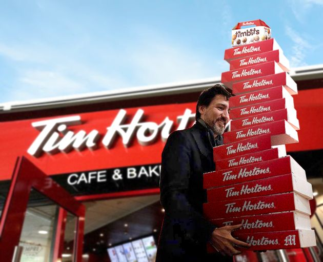 Canadian Prime Minister Justin Trudeau carrying boxes of Tim Hortons doughnuts